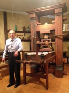 Lou Crandall with a replica of the Gutenburg Press.